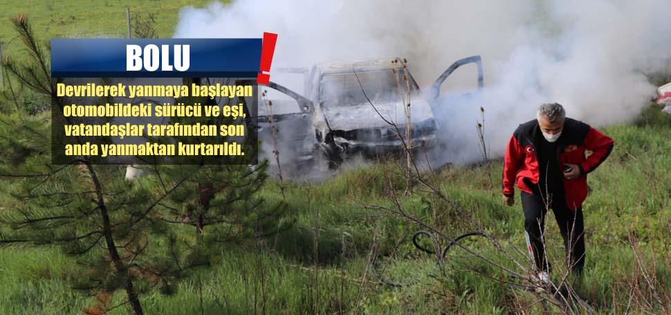 Çift, yanan araçtan son anda kurtarıldı